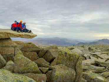 Scramblers enjoying a well deserved rest after a days scrambling on Glyder Fawr in Snowdonia.