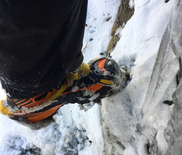 Scarpa Ribelle boots fitted with a crampon