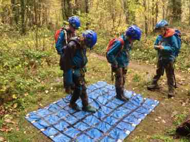 A group of children on an activity camp solving a puzzle