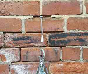 a climbing nut placement in a brick wall