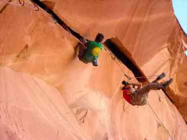 Alex Ekins photographing Ton Randall climbing Berry Full of Bad Berries in Indian Creek in Utah, USA © Pete Whittaker