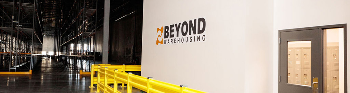 Inside the warehouse with logo on the wall