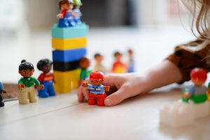 Speech Language Therapist playing with duplo