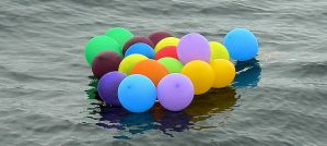 Discarded Balloon Bunch on the Water - Photo by Tim Lenz