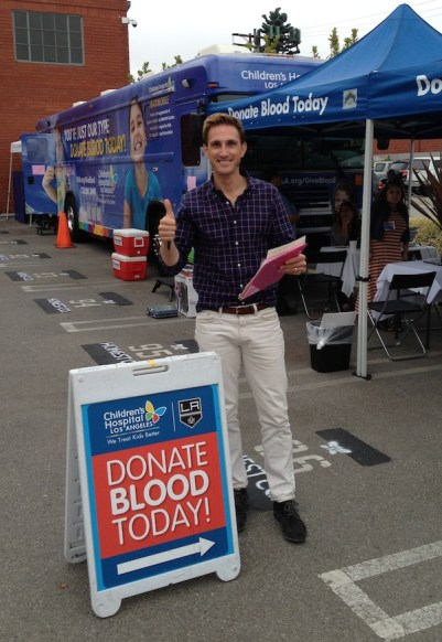Christopher Gavigan giving blood