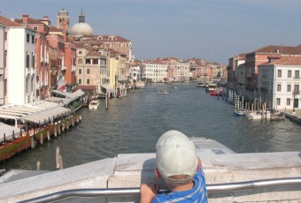 Child's Curiosity of Venice's Canal