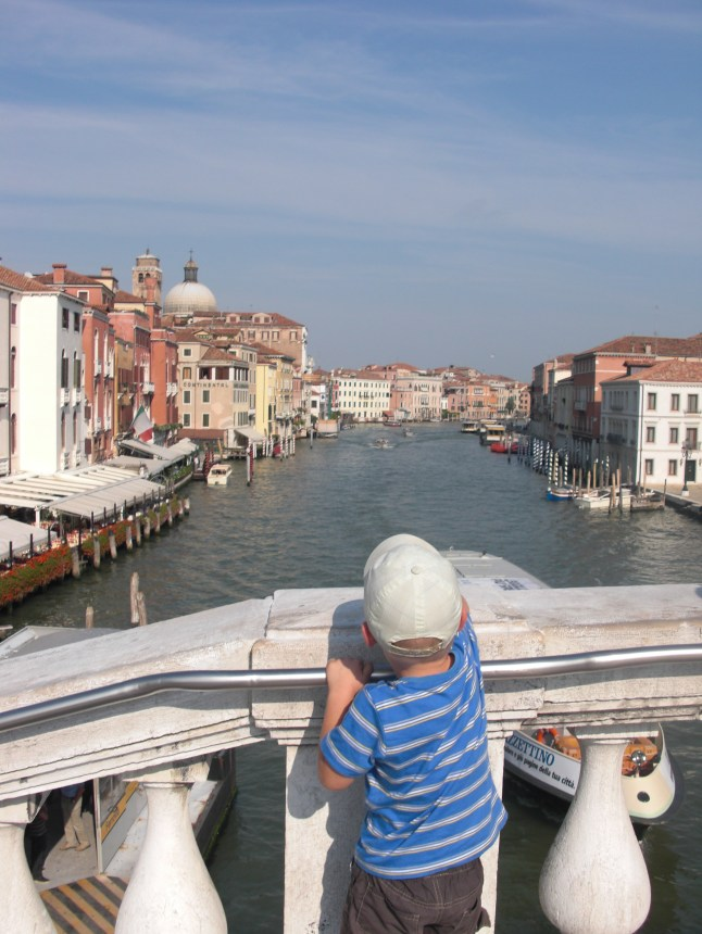 Child looking to Venice's Canal