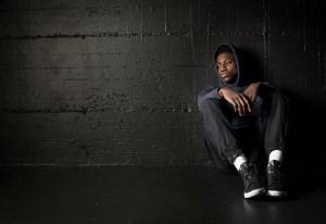 Sad black man in a empty room