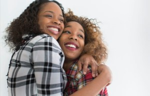black women hugging