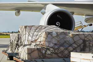 Air freight being loaded on cargo plane