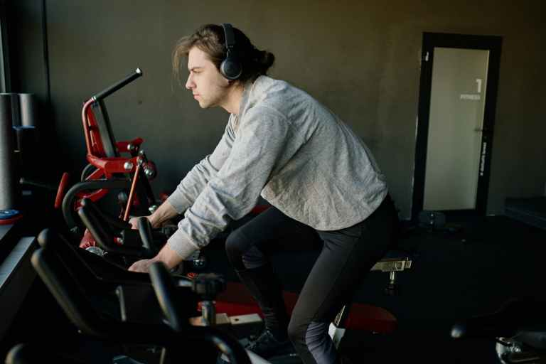 man training on an exercise bike