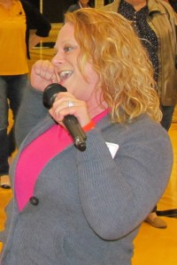 Action Auction - Nyla Ruccia belts out a cheer.