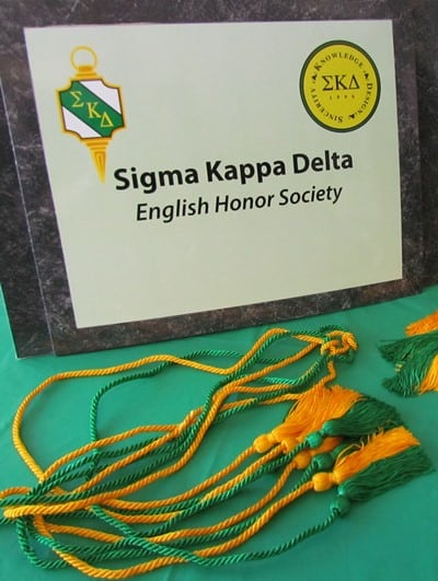 Sigma Kappa Delta sign with green & gold tassels