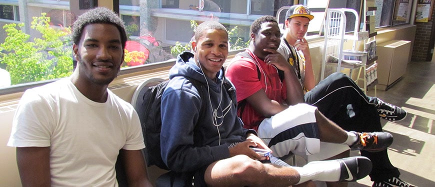 Male students sitting in walkway