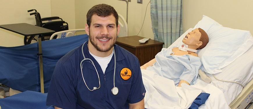 Male nursing student in scrubs