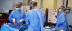 Surgical Tech students working in scrubs during lab