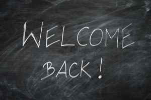 Welcome Back written on a black chalkboard