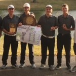 Five male golf players with awards and coach Huber