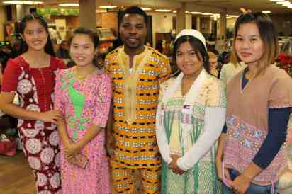 4 women & 1 man in colorful clothing from Thailand, Togo & Karen State
