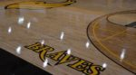 View of the basketball court with logos showing