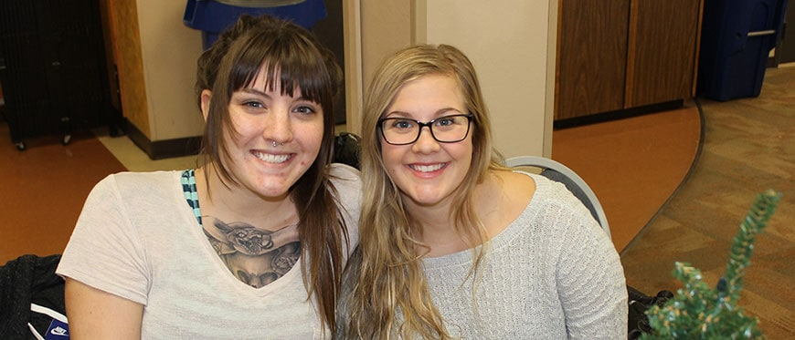 Two female students smiling at Fall Fest