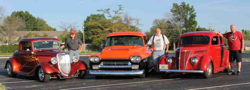 3 men with 1934 Ford, 1958 Chevy pickup & 1937 Ford