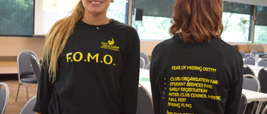 female students wearing Fear of Missing Out t-shirts