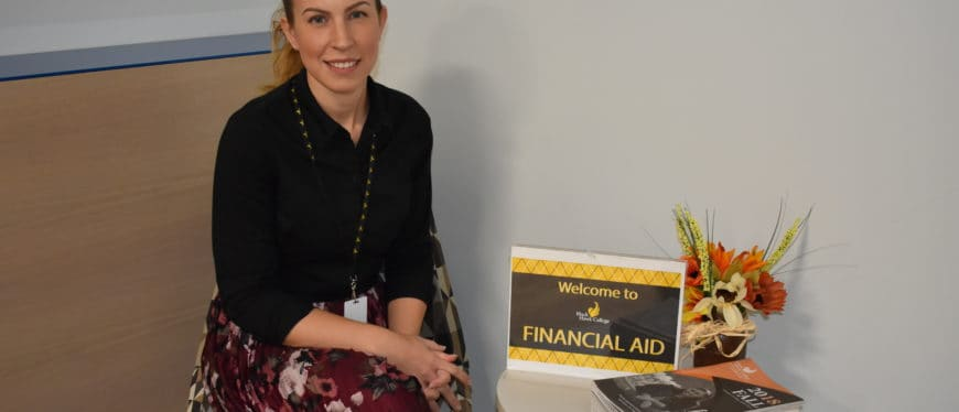 Financial Aid director sitting at table in Financial Aid office