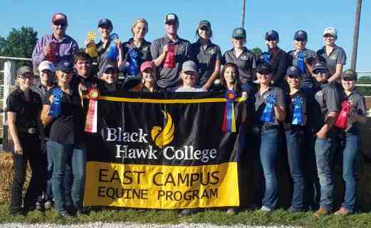 Group of students with ribbons & East Campus Equine Program banner