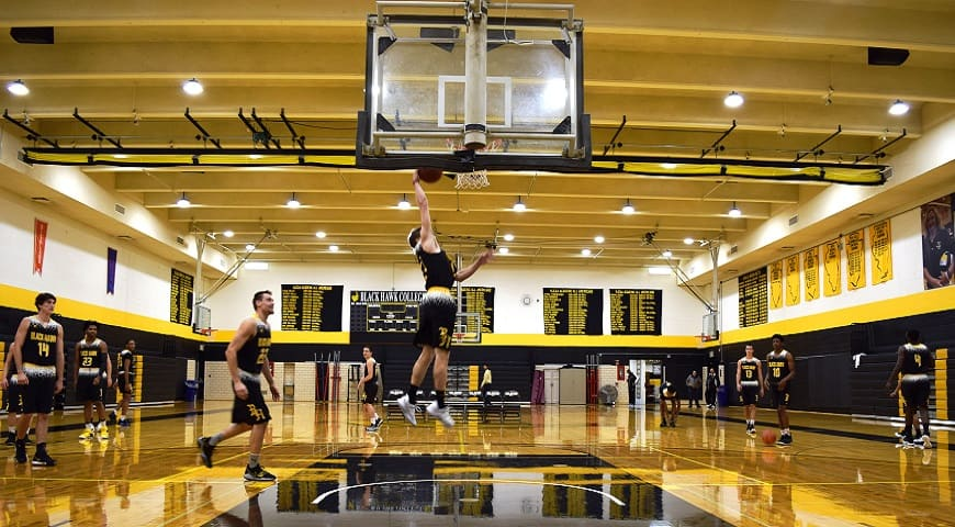 Men's basketball player does a right handed layup