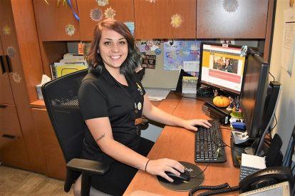 BHC career navigator Megan Hasselroth sits at her computer desk