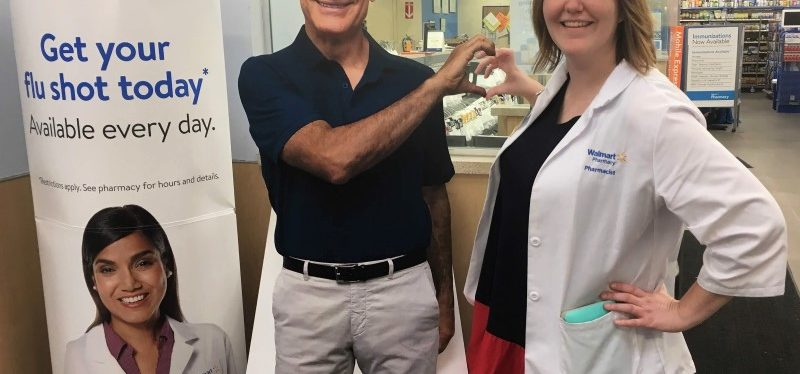 pharmacist posing with cutout of dr. oz