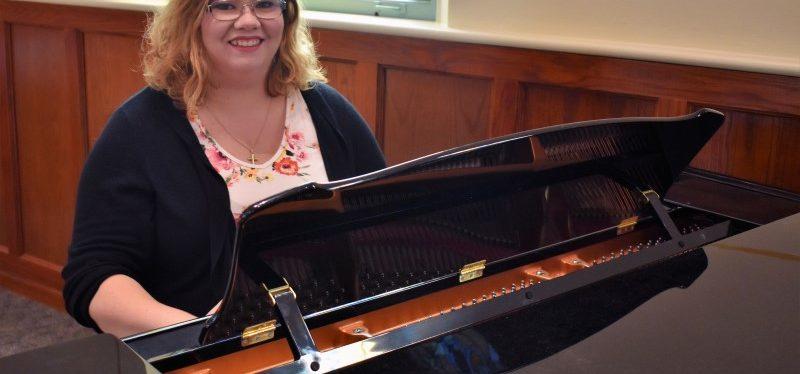 woman sitting at a piano