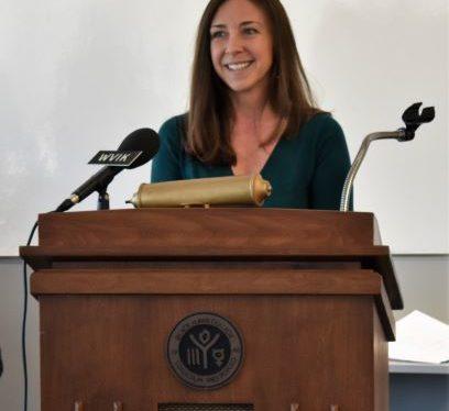Maria Ontiveros speaking at podium
