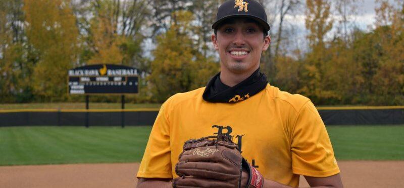 baseball player in the Black Hawk College field