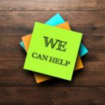 sticky note that says We can help