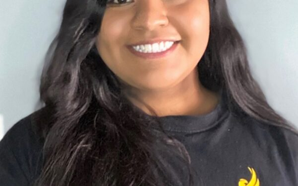 smiling female student wearing Black Hawk College Student Life t-shirt