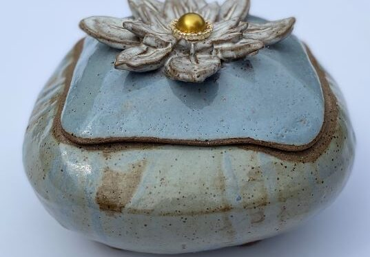 pottery bowl with water lily lid