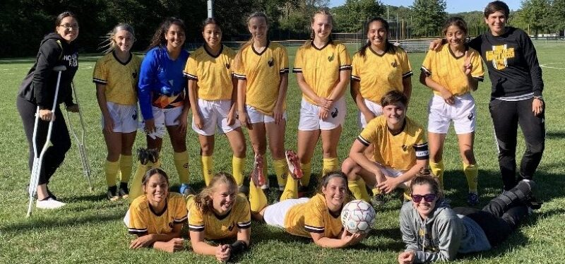 13 women's soccer players and 1 coach