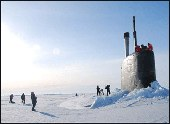 USS Connecticut surfaces through Arctic ice