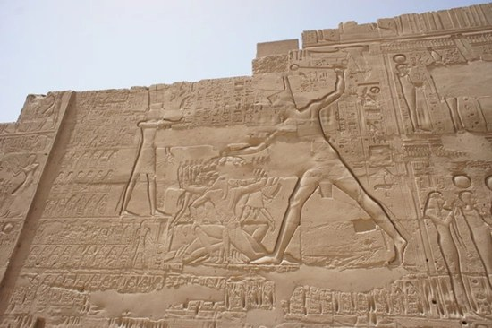 Egyptian relief showing slave driver beating slave