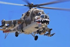 Military helicopter with face painted on it looks like locust insect