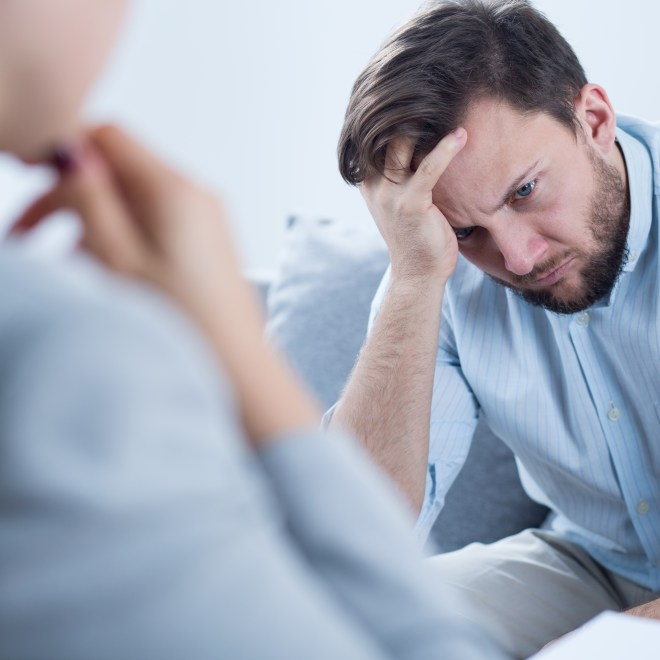 Photo of man with depression talking with counselor