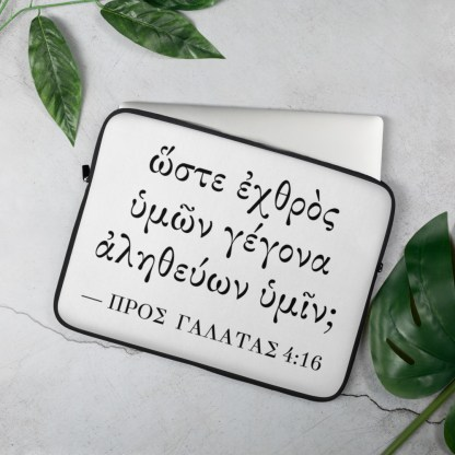 Laptop sleeve (15 inch) with Biblical Greek (Galatians 4:16) on table