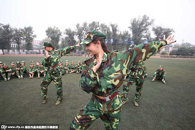 Chinese students in military uniform training.