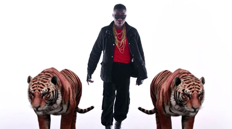 Reekado Banks Put In Pressure Music Video directed by Clarence Peters, produced by Kel P.
