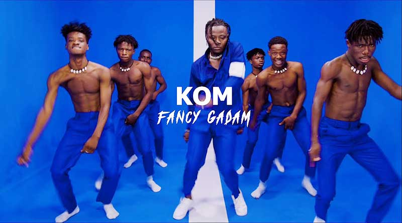 Fancy Gadam performing Kom Official Music Video directed by Kofi Awuah, song produced by Dr Fiza.