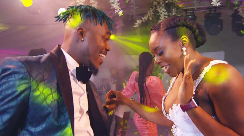 Camidoh featuring Kwesi Arthur performing Dance With You Music Video directed by George Britton and Norbert Dadson, song produced by Camidoh.