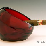 Ashtray orb designed and made in the mid-20th century. Beautiful, thick, deep ruby red glass. Scarce in this color and condition.