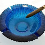 Dark blue heavy glass ashtray perfect for parties, patio and poolside.